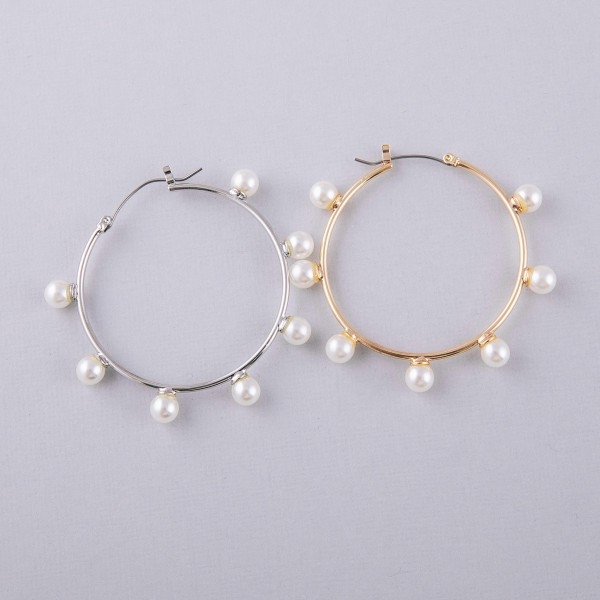 "Pearl beaded pin catch hoop earrings. Approximately 2"" in diameter."