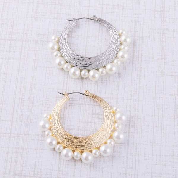 """Pearl beaded metal pin catch hoop earrings. Approximately 1.5"""" in diameter."""