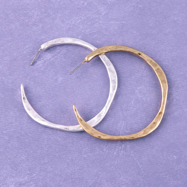 "Hammered metal open hoop earrings. Approximately 2"" in diameter."