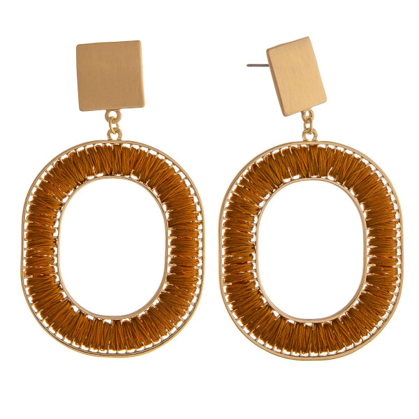 "Thread wrapped O dangle earrings with gold square stud accents. Approximately 2.5"" in length."