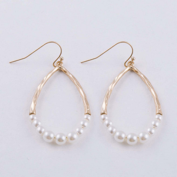 "Hammered pearl beaded teardrop earrings. Approximately 1.5"" in length."
