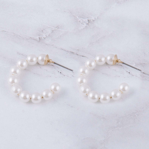"Pearl beaded open hoop earrings. Approximately 1"" in diameter."