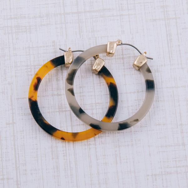 "Matte resin pin catch hoop earrings. Approximately 1.5"" in diameter."