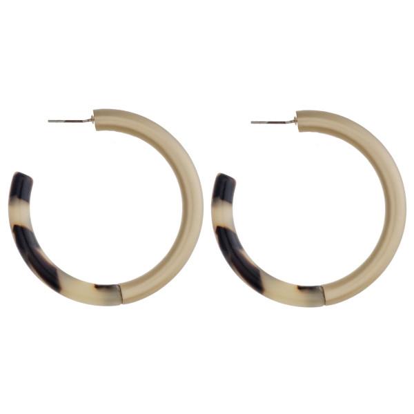 """Marble resin and metal open hoop earrings. Approximately 2"""" in diameter."""