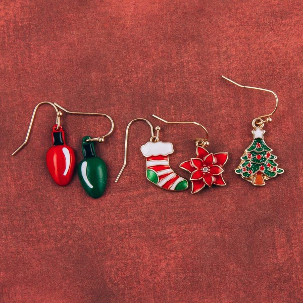 "Enamel coated Christmas stocking dangle earrings. Approximately .75"" in length."