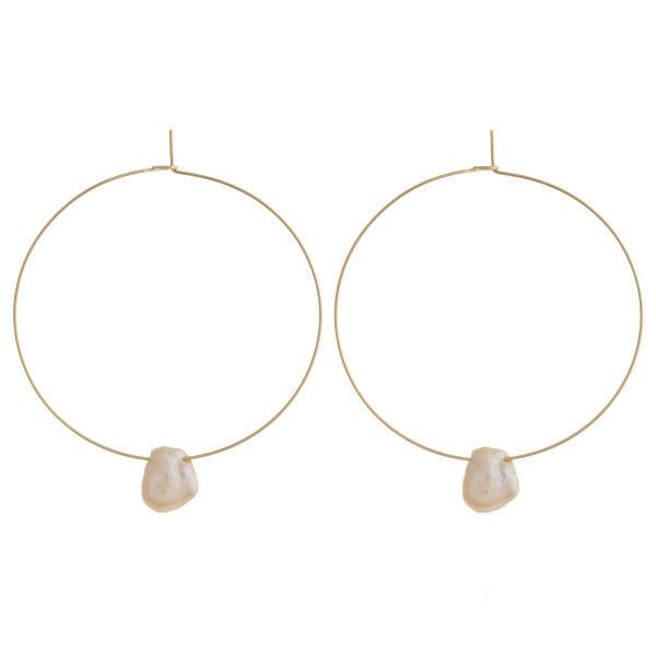 "Thin wire freshwater pearl hoop earrings. Approximately 1.75"" in diameter."
