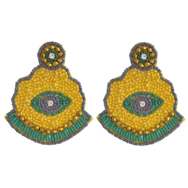 """Seed beaded felt evil eye earrings with rhinestone accents. Approximately 3"""" in length."""