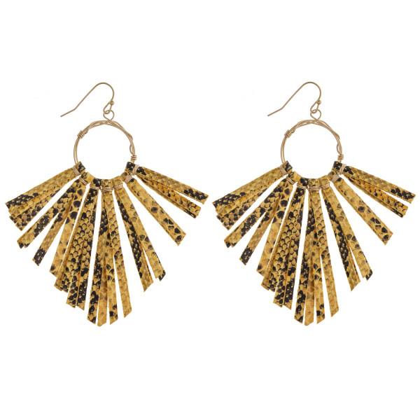 "Wire wrapped faux leather snakeskin tassel drop earrings. Approximately 3.25"" in length."