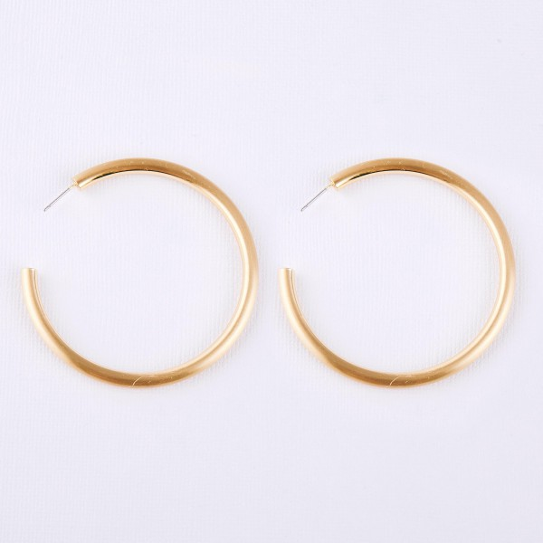 "Matte Gold open hoop earrings.  - Approximately 2"" in diameter - Thickness 3mm in diameter"