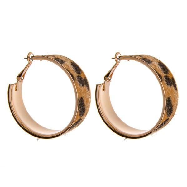 """Faux fur cheetah print metal hoop earrings.   - Approximately 1.5""""  in diameter - Approximately .5"""" wide"""