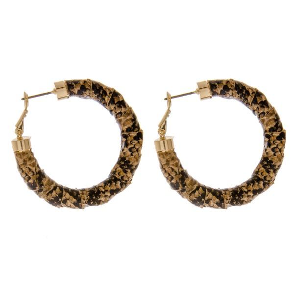 "Faux leather snakeskin wrapped hoop earrings.  - Approximately 1.75"" in diameter"