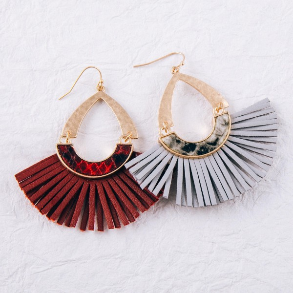 "Hammered hinge teardrop faux leather tassel earrings with snakeskin details.  - Approximately 2.5"" in length"