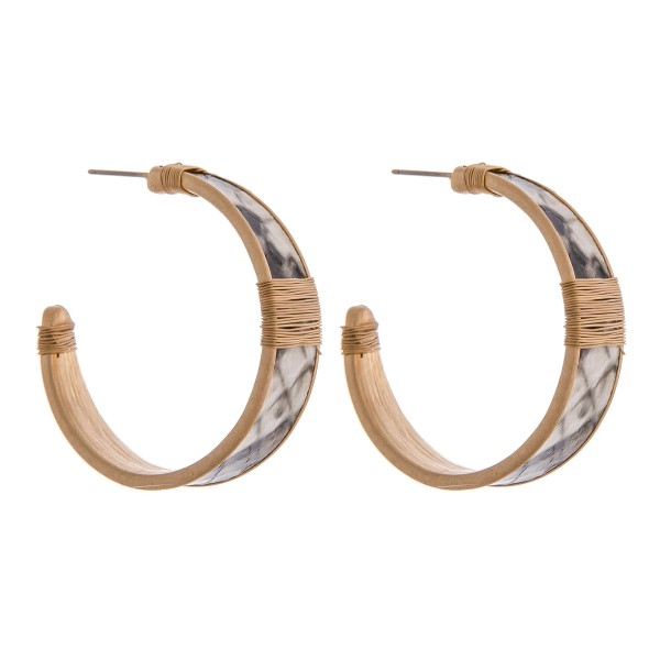 """Faux leather snakeskin hoop earrings with wire wrapped details.  - Approximately 1.5"""" in diameter - Approximately 1cm in width"""