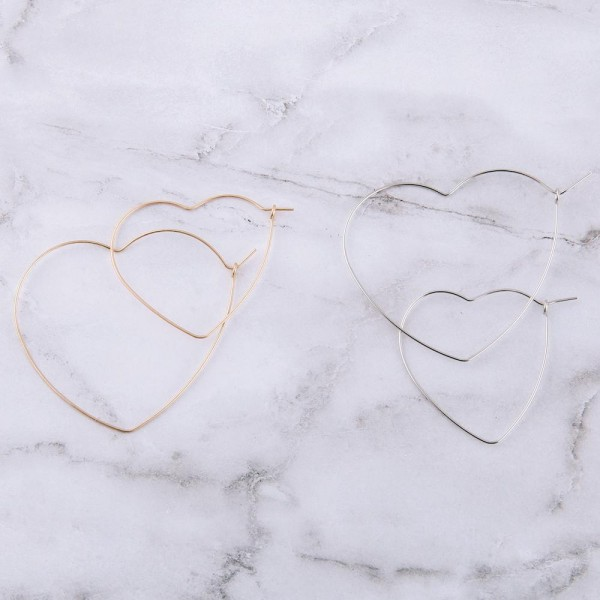 "Flexible brass metal heart wire hoop earring set of two.  - Smallest size 1.5"" in length - Largest size 2"" in length"