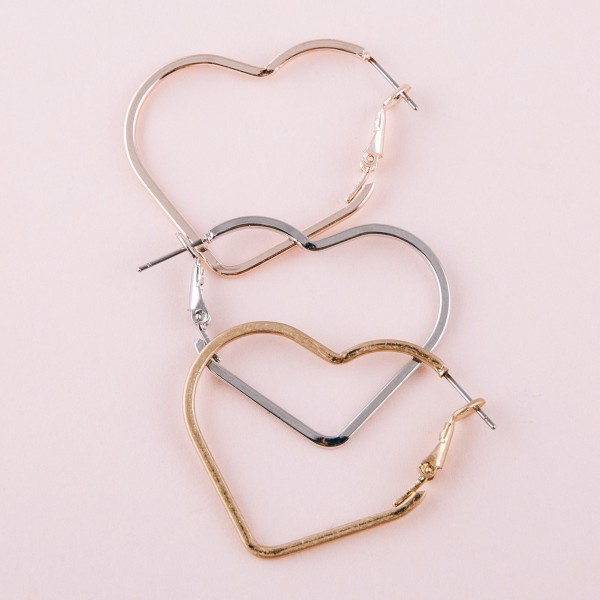 "Metal heart hoop earrings.  - Approximately 1.5"" in length"