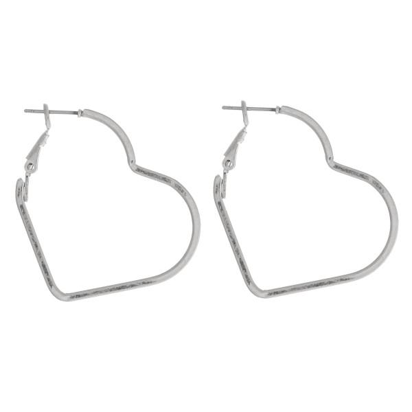 """Metal heart hoop earrings.  - Approximately 1.5"""" in length"""