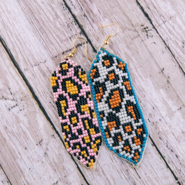 "Seed beaded blue leopard print loom earrings.  - Approximately 4"" in length"