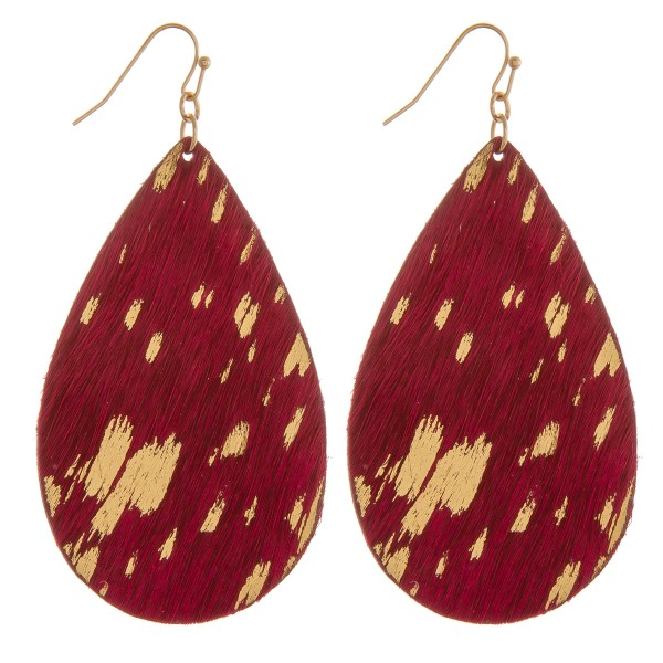 "Metallic cowhide teardrop earrings.  - Approximately 3"" in length"