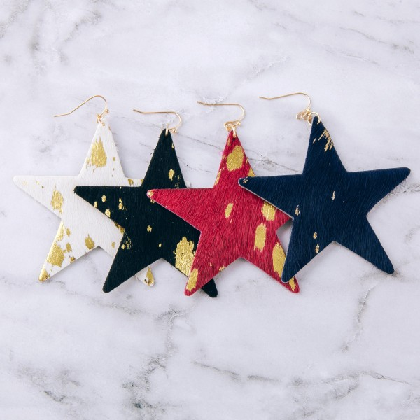 "Metallic cowhide star cut out earrings.  - Approximately 3"" in length and size"