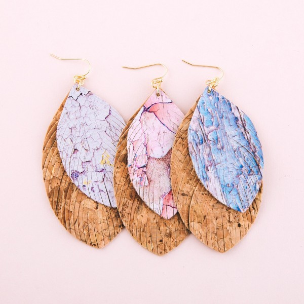 "Faux cork marble print feather statement drop earrings.  - Approximately 4"" L"