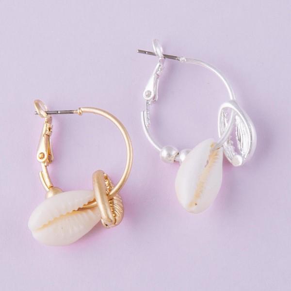 "Puka shell hoop earrings.  - Approximately 1"" in length"