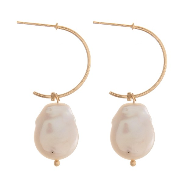 "Pearl open hoop earrings.  - Approximately 1.5"" in length"