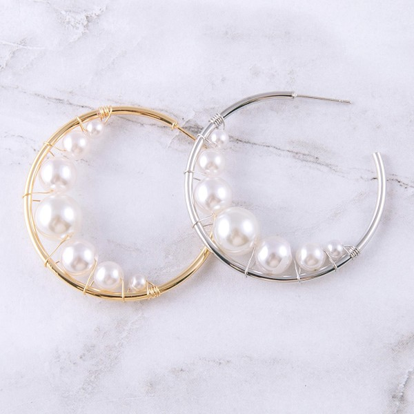 "Inner pearl beaded hoop earrings.  - Approximately 1.5"" in diameter"