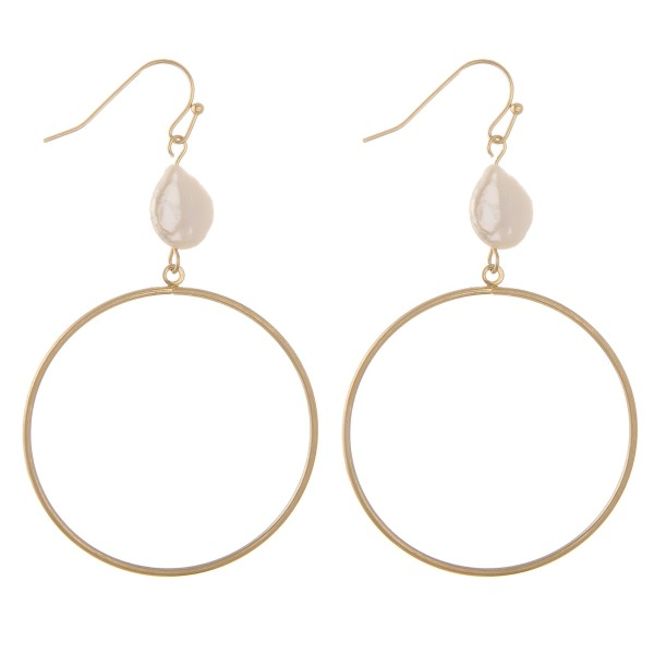 "Faux pearl disc drop earrings.  - Approximately 2.75"" L - Disc approximately 1.5"" in diameter"