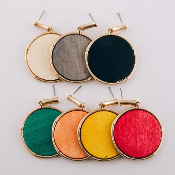 "Modern wood encased drop disc earrings.  - Approximately 2"" in length and 1.5"" in diameter"