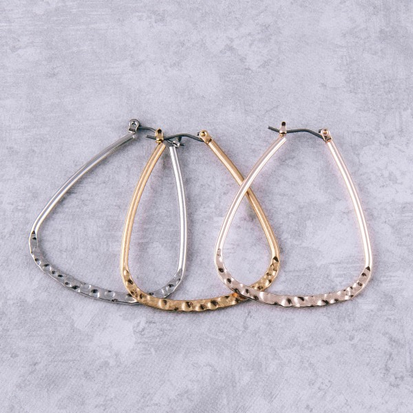 """Rounded triangular hammered hoop earrings.  - Approximately 1.5"""" in length"""