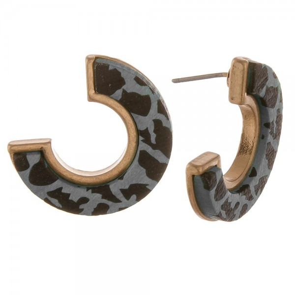 "Animal print wood encased open circle stud earrings.  - Approximately 1"" in diameter"