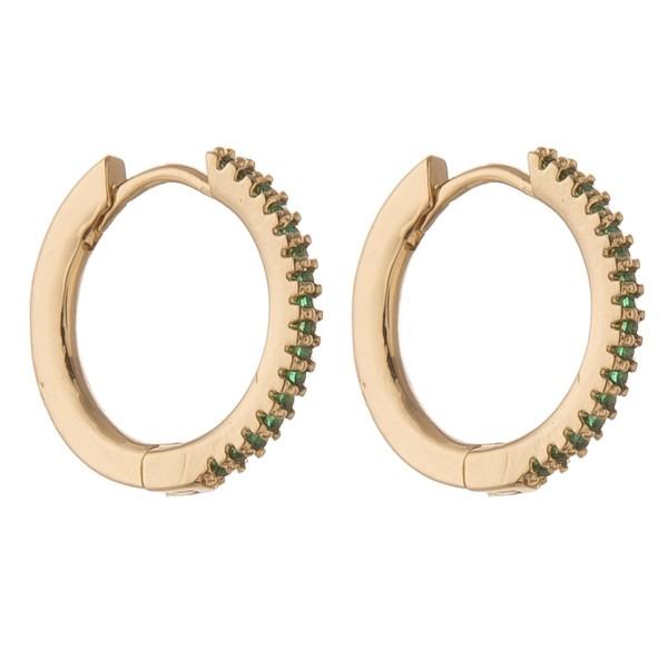 "Cubic zirconia huggie hoop earrings.  - Cubic Zirconia  - Approximately .75"" in diameter"