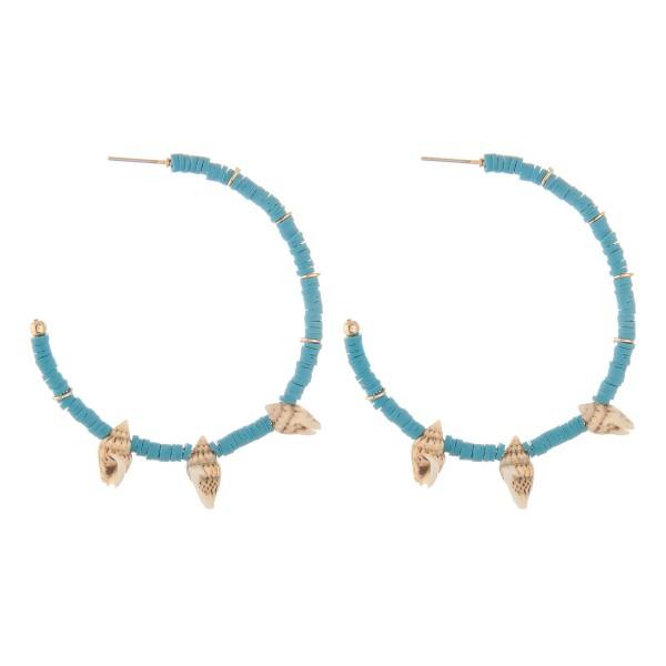 "Rubbery spacer beaded seashell hoop earrings.  - Approximately 2"" in diameter"