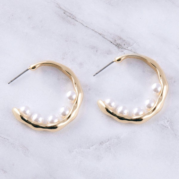 "Gold pearl beaded open hoop earring.  - Approximately 1.25"" in diameter"