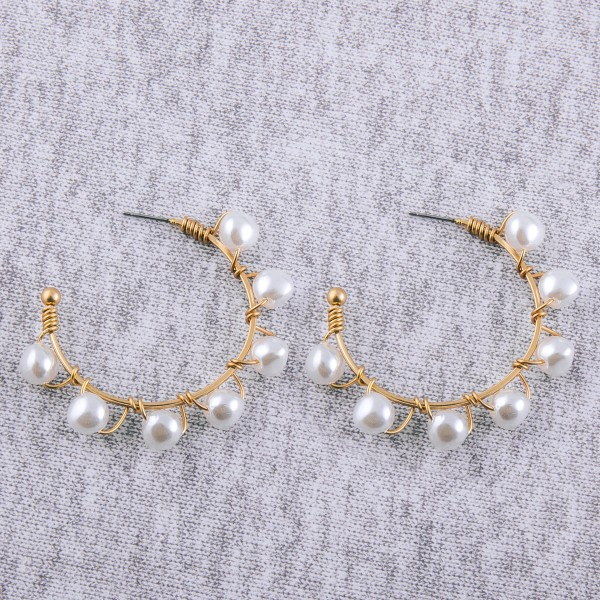 "Wire wrapped pearl beaded statement open hoop earrings.  - Approximately 2"" in diameter"
