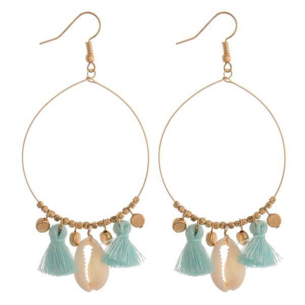 "Puka shell tassel earrings.  - Approximately 3"" in length"
