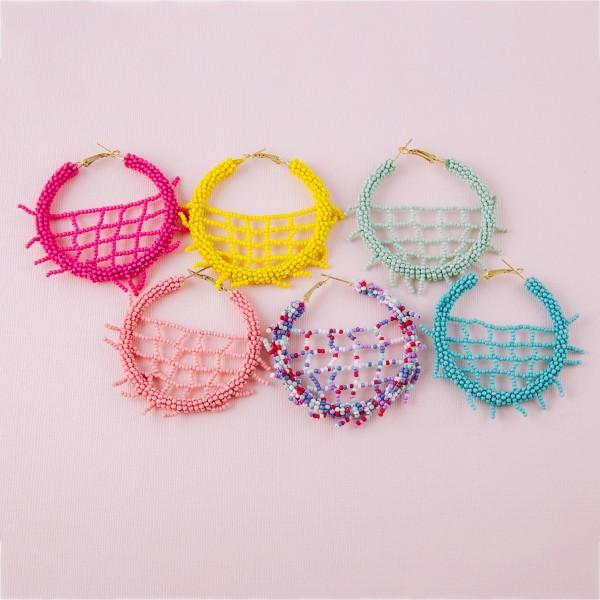 "Seed beaded woven fringe statement hoop earrings.  - Approximately 2.5"" in diameter"