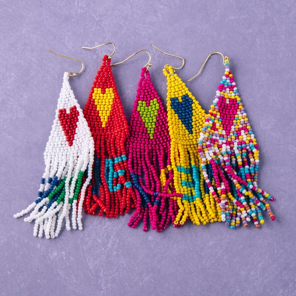 "Seed beaded heart fringe tassel earrings with LOVE details.  - Approximately 3.5"" in length"
