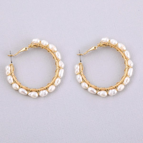 "Gold wire wrapped pearl beaded hoop earrings.  - Approximately 1.5"" in diameter"