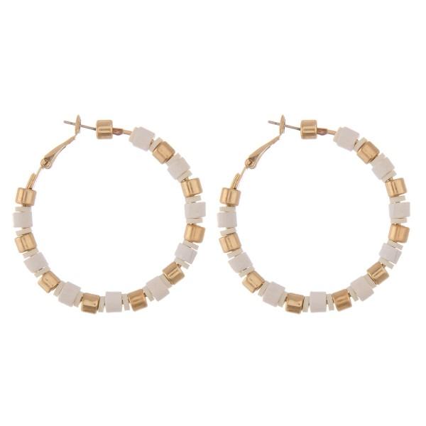 """Coated block beaded hoop earrings with spacer bead details.  - Approximately 1.75"""" in diameter"""
