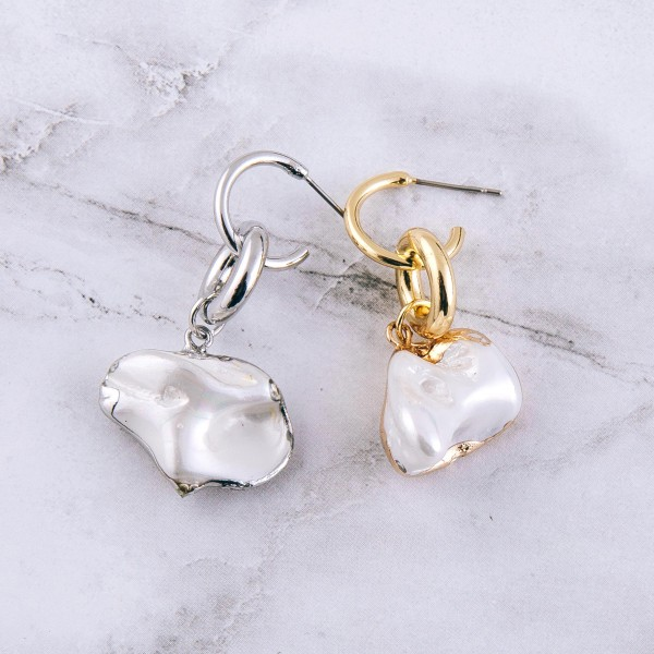 "Faux pearl huggie hoop drop earrings.  - Approximately 1.5"" L - Pearl may vary in size"