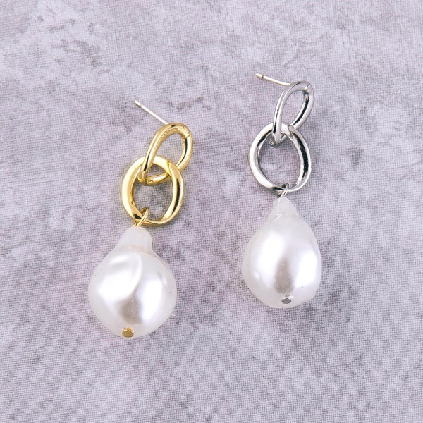 "Faux pearl drop earrings.  - Approximately 1.5"" L - Pearl may vary in size"