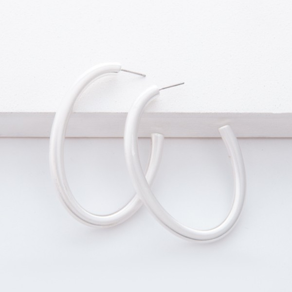 "Satin Silver Open Oval Hoop Earrings.  - Approximately 2"" L"