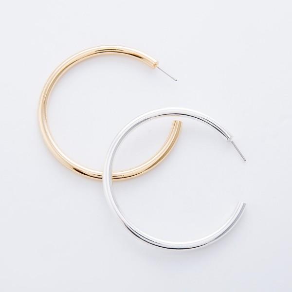 "Satin Gold Hoop earrings.  - Approximately 2.25"" in diameter - Hoop Thickness 3mm"