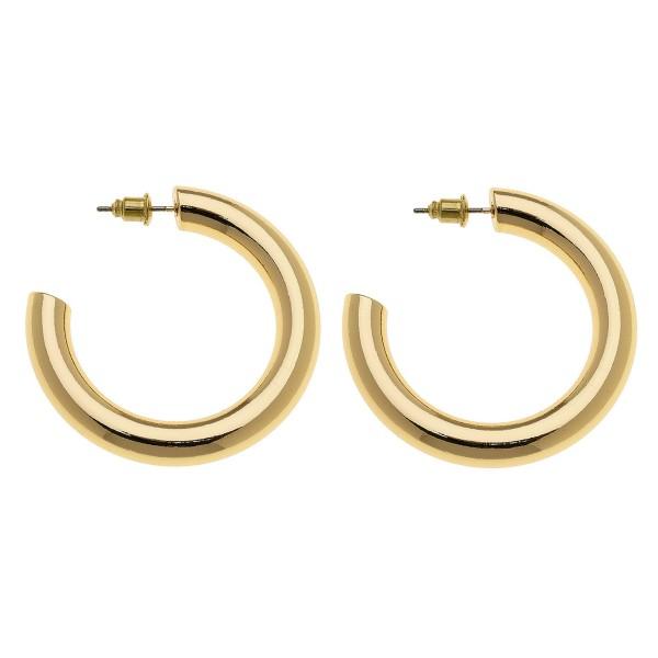 "Satin Gold open hoop earrings.  - Approximately 1.5"" in diameter - Hoop Thickness 5mm"