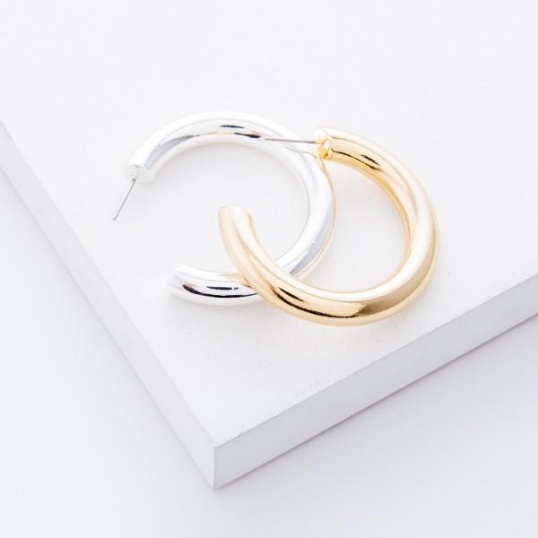 "Satin Silver open hoop earrings.  - Approximately 1.5"" in diameter - Hoop Thickness 5mm"
