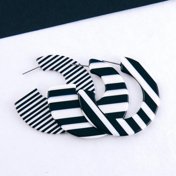 "Black and White stripe resin hoop earrings.  - Approximately 2"" in diameter"