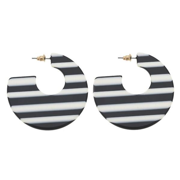 "Black and White stripe resin retro hoop earrings.  - Approximately 2"" in diameter"