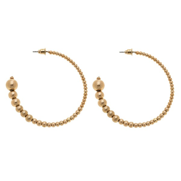 "Worn Gold graduated sphere beaded hoop earrings.  - Approximately 2"" in diameter"