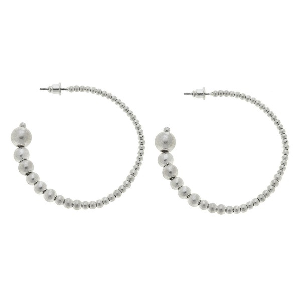 "Worn Silver graduated sphere beaded hoop earrings.  - Approximately 2"" in diameter"